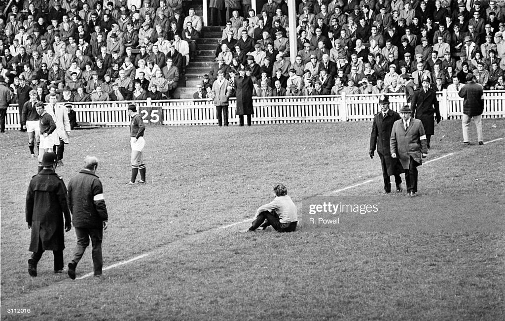 Police at a Springboks versus Miidland Counties rugger match after antiapartheid demonstrators invaded the pitch