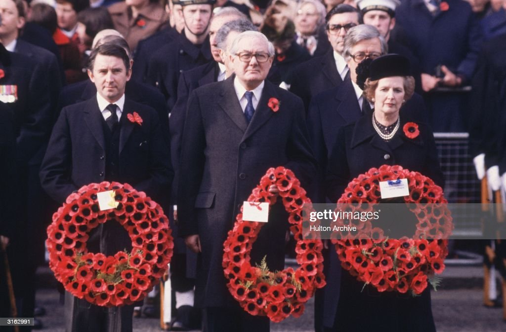 From left to right, Liberal Party leader David Steel, former Labour leader James Callaghan and Conservative prime minister Margaret Thatcher carrying wreaths of poppies during a Remembrance Day service at the Cenotaph, Whitehall, London.
