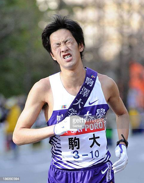 10th runner of Komazawa University Kensuke Gotoda shows his dejection after finishing second during the 88th Hakone Ekiden on January 3 2012 in Tokyo...