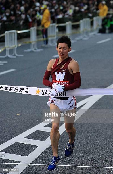 10th runner of Waseda University Soichiro Ichikawa crosses the finish tape at fourth during day two of the 88th Hakone Ekiden on January 3 2012 in...