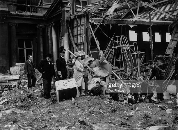 King George VI of Great Britain Queen Elizabeth and Prime Minister Winston Churchill inspecting bomb damage at Buckingham Palace