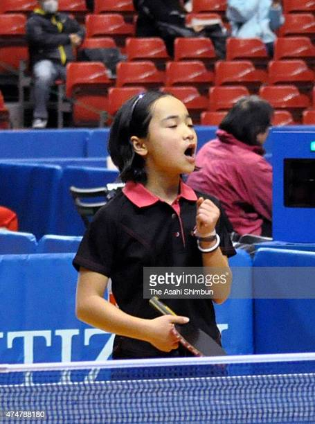 10yearold Mima Ito celebrates a point during her Women's Singles second round match in the day two of the All Japan Table Tennis Championships at...