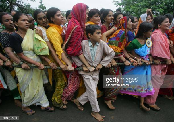 MUMBAI INDIA JUNE 27 2006 10yearold Raju Ranjan resident of Mira Road student of BMS English High School gets squashed amid female devotees pulling...