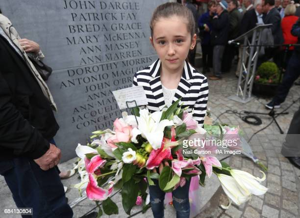 10yearold Roseanna Grace whose grandmother Breda Grace was killed in the Talbot Street bomb holds a wreath during a memorial ceremony in Dublin's...