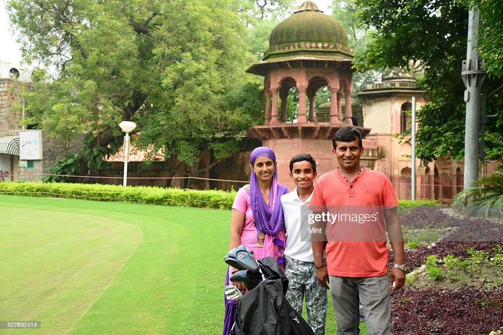 10-year-old Shubham Jaglan who won Junior World Golf Championship 2015 in San Diego, California, with his mother and father on August 10, 2015 in New Delhi, India. Jaglan was born in village Israna, Panipat district, Haryana. His father is a milkman by profession and his family practices Pehlwani. He is receiving his primary education in his village.