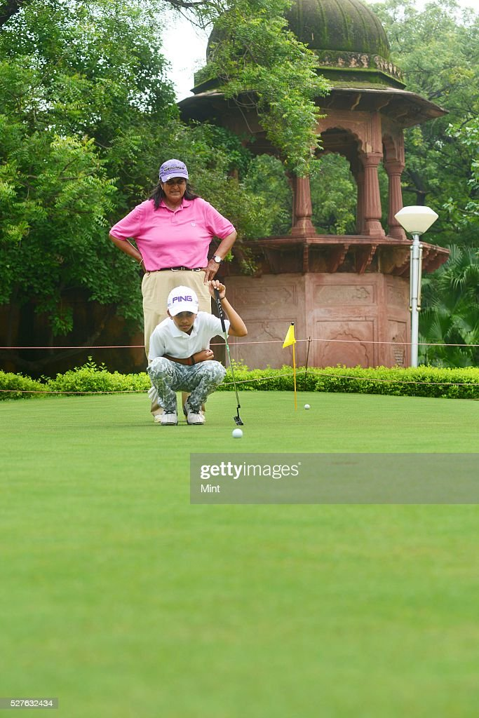 10-year-old Shubham Jaglan who won Junior World Golf Championship 2015 in San Diego, California, with his coach Mrs Kureshi at Delhi Golf Club on August 10, 2015 in New Delhi, India. Jaglan was born in village Israna, Panipat district, Haryana. His father is a milkman by profession and his family practices Pehlwani. He is receiving his primary education in his village.