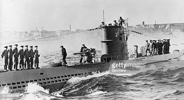 Kiel Germany One of Germany's undersea commerce raiders is shown crew lined up on the decks and officers in the conning tower as it arrived at the...