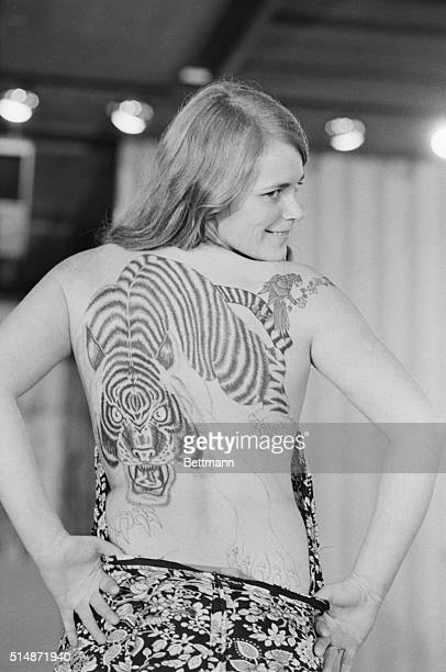 1/11/1980Sacramento CA Kathy Sundahl a Californian gives judges a look at her tiger tattoo during a competition in the women's division of the beauty...