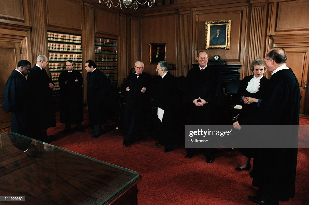 Chief Justice of the U.S. Supreme Court William Rehnquist and the newly installed Associate Justice Clarence Thomas (l) in the Supreme Court building. All nine Supreme Court Justices are shown.