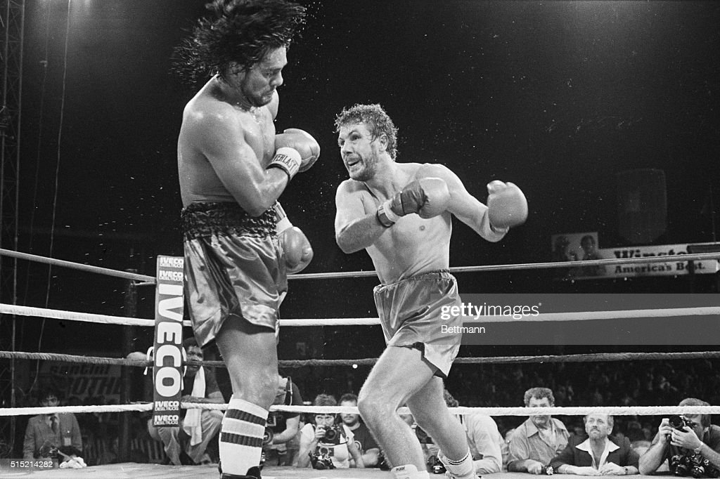 Miami FL Former lightweight and welterweight champ Roberto Duran is pushed back by a right thrown by Jimmy Batten in their bout following the main...