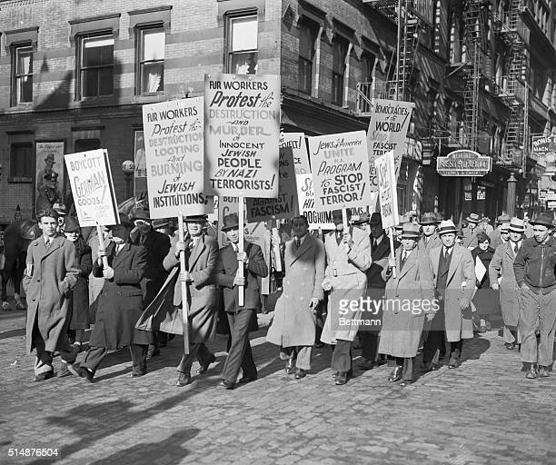 New York NY Some of the hundreds who attended an antiNazi meeting in New York City's garment and fur district today November 15 Signs carried by the...