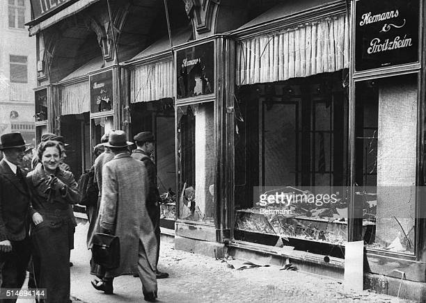 A street scene in Berlin showing the shattered fronts of Jewishowned stores the result of antiJewish demonstrations following the slaying of Ernst...
