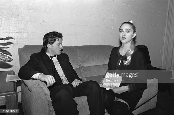 Sean Penn and Madonna sit on a couch backstage prior to the start of a starstudded show at the Third Annual Commitment to Life Celebration held at...