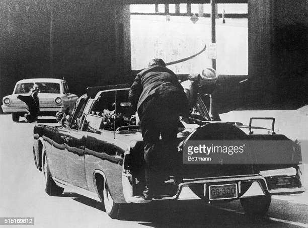 Assassination of President Kennedy Mrs Kennedy leans over dying President as a Secret Service man climbs on back of car