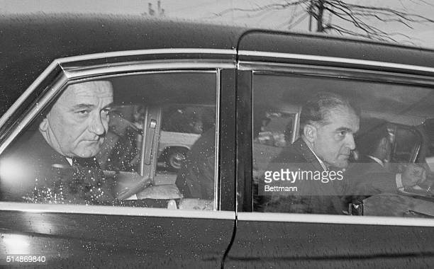 Washington DC President Lyndon B Johnson in a rain splattered car leaves his home Nov 23 for his office in the Executive Office Building The...
