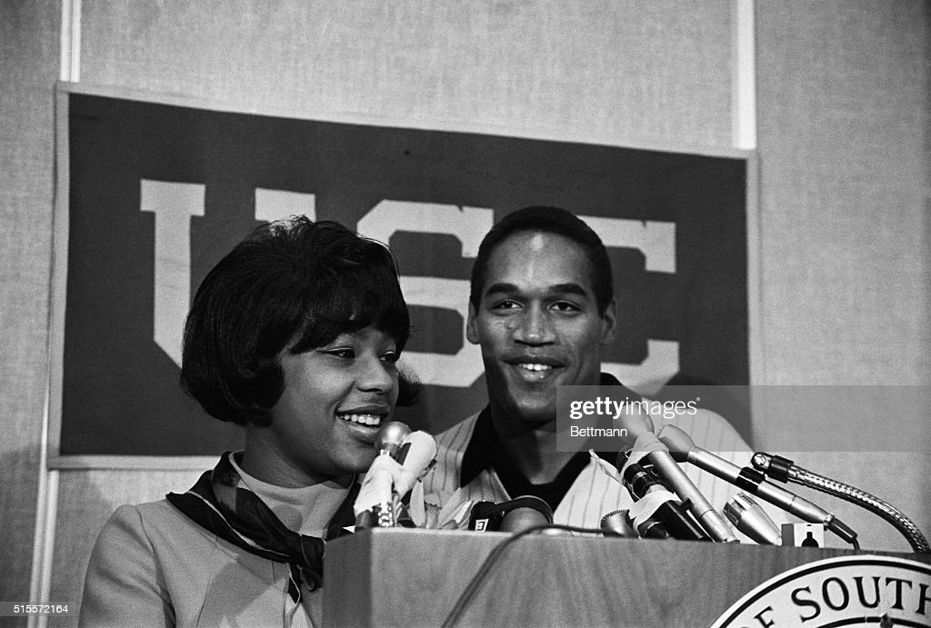 Los Angeles USC halfback OJ Simpson and his wife Margaret smile happily at a press conference 11/26 after he was named winer of the 1968 Heisman...