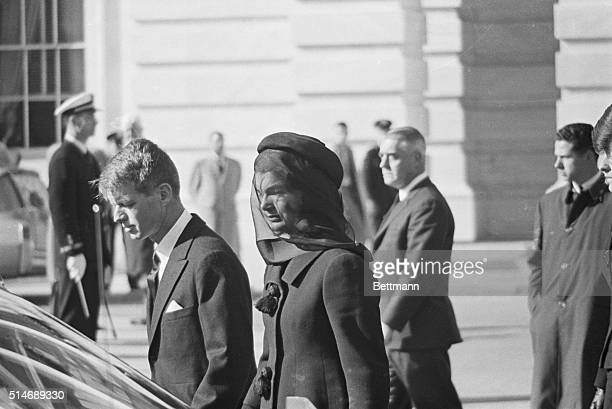 11/26/63Arlington Virginia Mrs Jacqueline Kennedy walks with her brotherinlaw Attorney General Robert Kennedy Photo is during funeral ceremonies for...