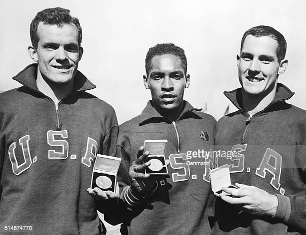 Melbourne Australia American athletes with their medals after sweeping to victory in the final of the 110 meters hurdles L to r Joel Shankle who was...