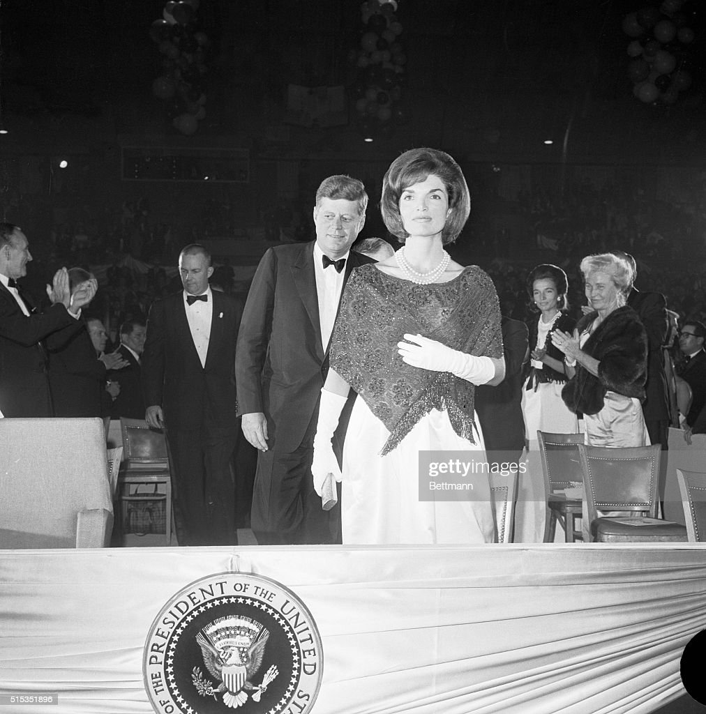 Washington, DC- President and Mrs. Kennedy are shown as they film a nationwide closed circuit television show, 'An American Pageant of the Arts,' to boost a National Culture Center. Here, Mrs. Kennedy is shown in front of President Kennedy in the National Guard Armory.