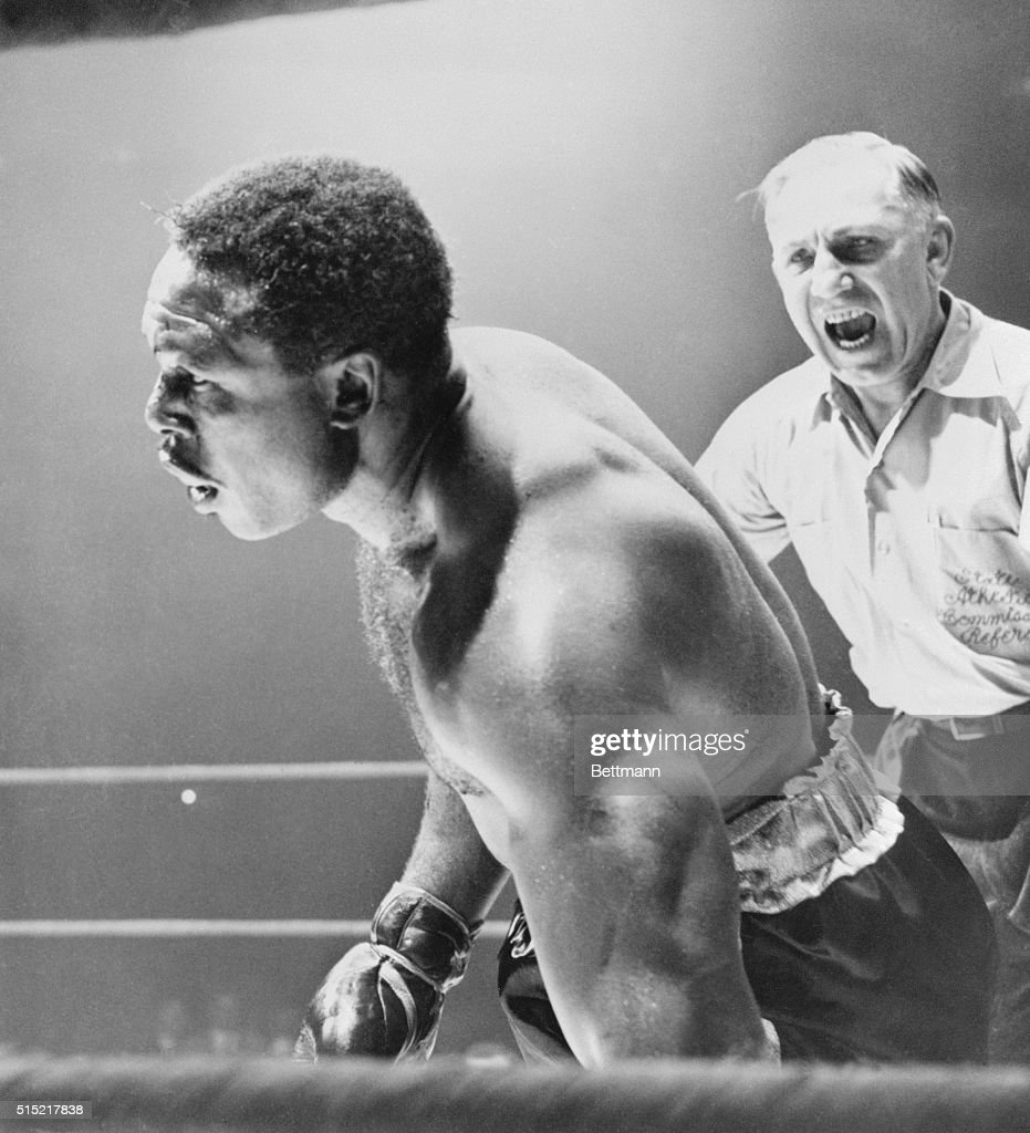 Chicago, IL- <a gi-track='captionPersonalityLinkClicked' href=/galleries/search?phrase=Archie+Moore&family=editorial&specificpeople=93092 ng-click='$event.stopPropagation()'>Archie Moore</a> begins his fall to the canvas as he goes down for the nine-count in the 5th round of his heavyweight title bout against Floyd Patterson. A moment later Patterson became the youngest heavyweight champion in history by knocking out Moore at 2:27 of the round. The referee is Frank Sikora.
