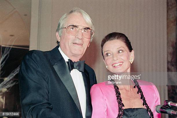 New York NY Gregory Peck shares a happy moment with Audrey Hepburn after presenting her with the first annual Winternight Award on behalf of the...