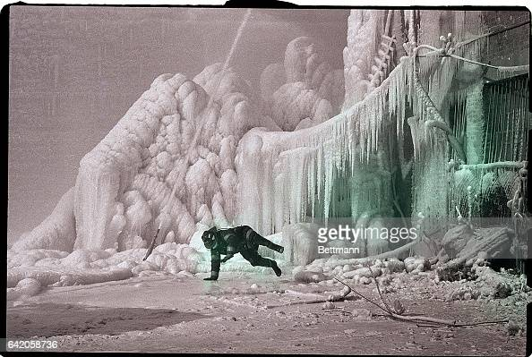 Trying to adjust a hose a fireman slips and falls on the frozen site of a warehouse fire on New York's west side January 13 Temperatures in the teens...