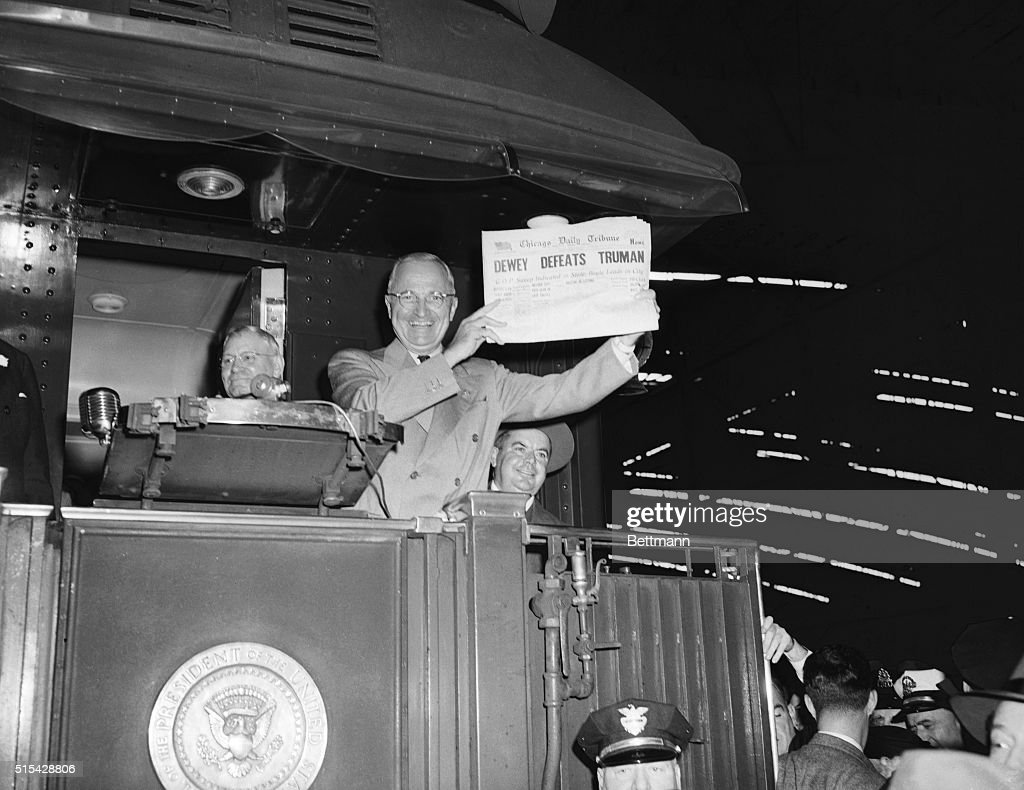 This photo of President Harry S. Truman laughing as he holds an early edition of the Chicago Tribune for Nov. 4th, 1948, was taken by United Press staff photographer Frank Cancellare. The newspaper, whose headline jumped to an erroneous conclusion as early election returns came in, was shown to Truman as he stopped here during his victorious return trip to Washington, D.C. Photo shows Truman in general view at the podium.
