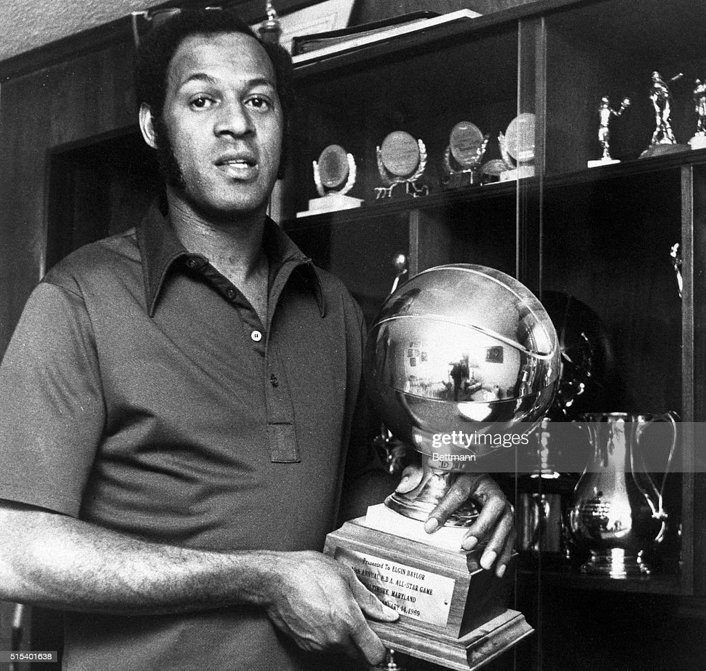 Elgin Baylor Posing with All Star Trophy