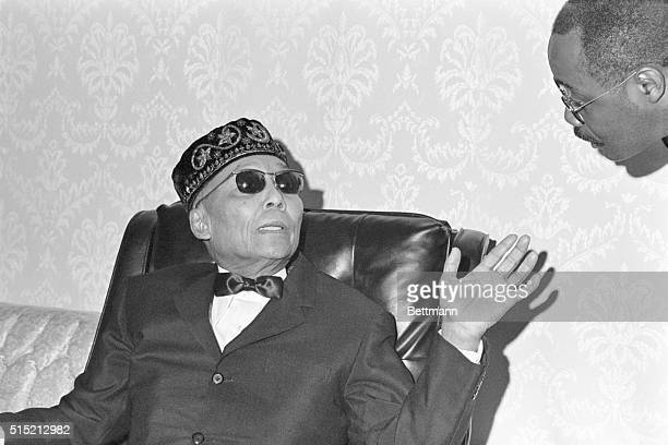 Elijah Muhammad leader of the Black Muslims a black seperatist sect gestures during his first news conference in seven years held in the sitting room...
