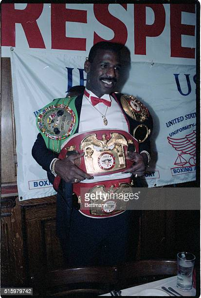 11/5/1985Michael Spinks heavyweight champ shows some of the belts he has won and wil now give back