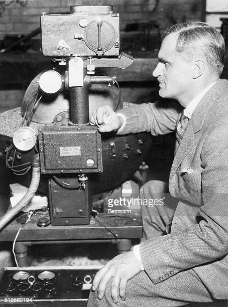 1/17/1936Dr Arthur H Compton University of Chicago Pysicist is shown above with a stationary cosmic ray meter similar to the machine that he will...