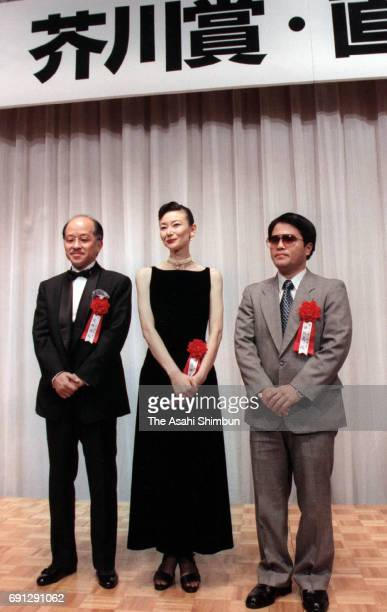 117th Naoki Prize laureates Jiro Asada and Setsuko Shinoda 117th Akutagawa Prize laureate Shun Medoruma pose for photographs on August 22 1997 in...