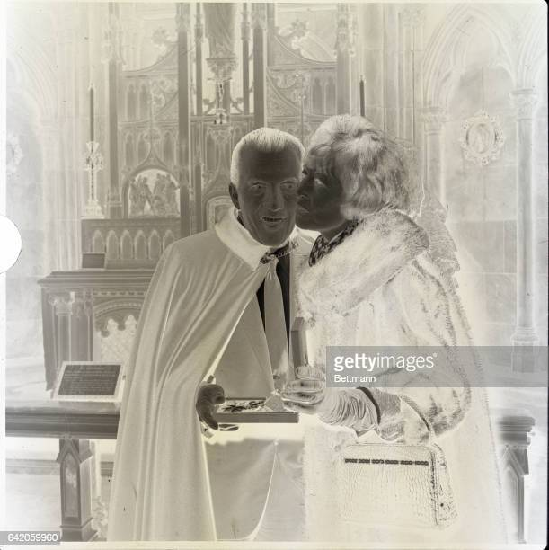 1/18/1965New York New York Television personality Ed Sullivan gets a kiss from his wife Sylvia after being installed as a Knight of Malta in solemn...
