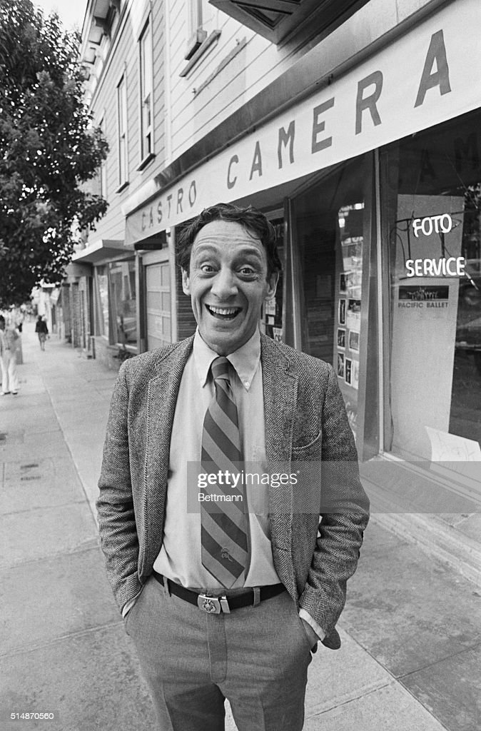 Supervisor Harvey Milk poses outside his camera shop after his 1977 election to the Board of Supervisors. Milk and Mayor George Moscone were assassinated at City Hall by resigned supervisor Dan White.