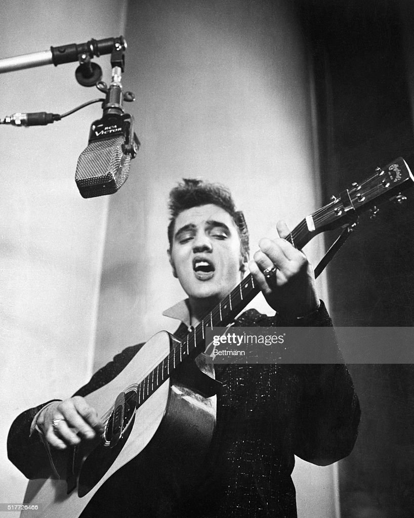 close up of elvis presley playing guitar show more elvis presley playing guitar