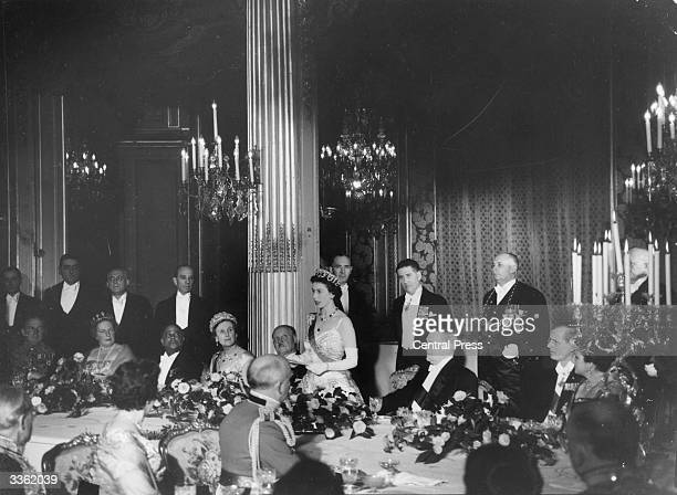 The Queen gives a speech at a banquet at The Elysee Palace in Paris To the right of her is French President Rene Coty