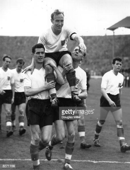 England captain Billy Wright is carried shoulder high by team mates Don Howe and R Clayton following their win over Scotland at Wembley Wright is...