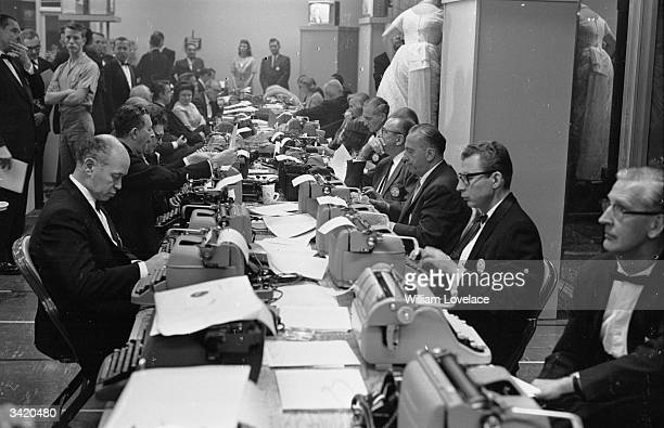 Journalists typing up their reports in the press room at the Oscars award ceremony in Hollywood