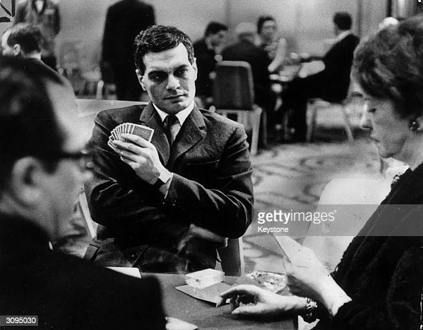 Egyptian actor Omar Sharif competes in a bridge tournament in London