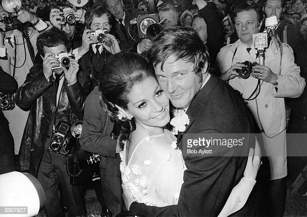 Italian actress Luisa Mattioli and English actor Roger Moore outside Caxton Hall London after their wedding ceremony