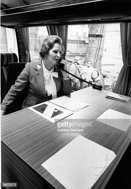 Margaret Thatcher making a telephone call in the Conservative Party coach during her election campaign