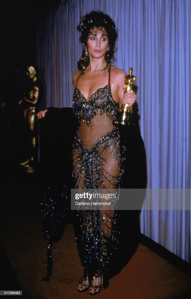 11th April 1988 American actor and singer Cher holds her Academy Award for Best Actress for her role in director Norman Jewison's film 'Moonstruck'...
