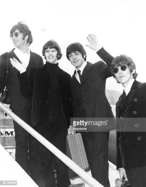 English pop group The Beatles wave goodbye from the steps of an aeroplane as they leave for a tour of America