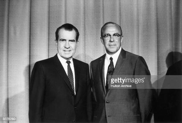 US Presidentelect Richard M Nixon standing with his newly named Secretary of Labor George P Shultz after announcing his cabinet appointment...