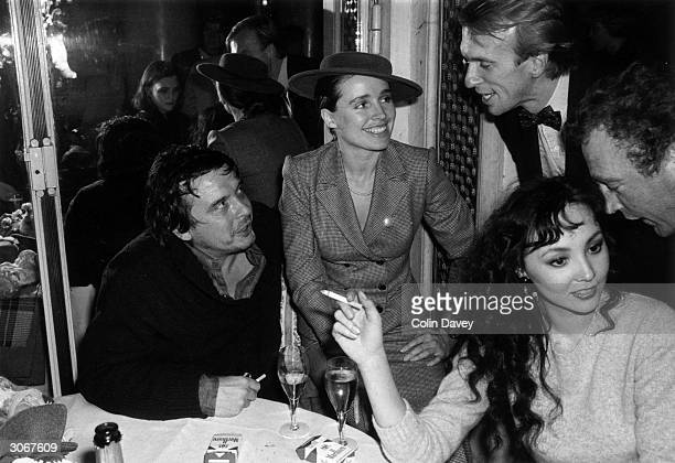 British photographer David Bailey with his wife Marie Helvin at a party given by the British society magazine Tatler