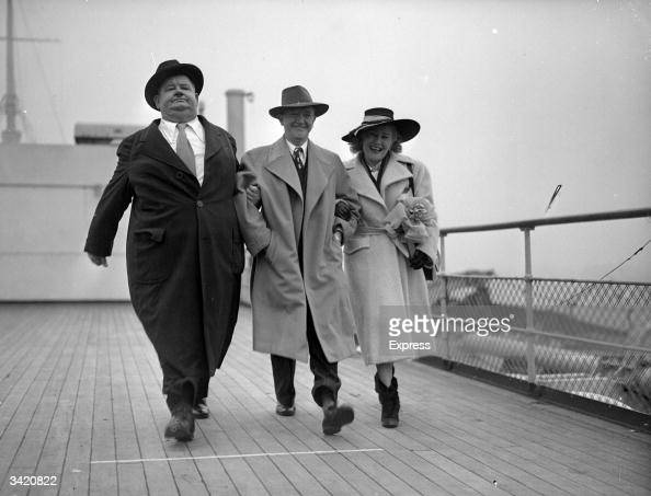 American film star and comedian Oliver Hardy with his British born partner Stan Laurel and his wife Virginia Laurel on board a ship in England