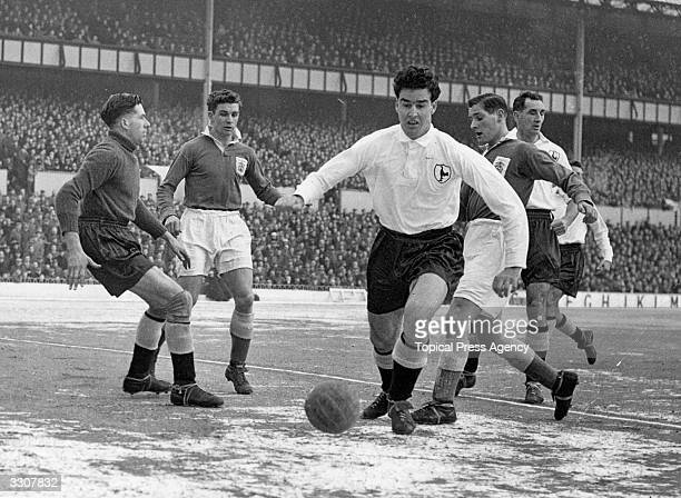 Maurice Norman of Tottenham Hotspur helps goalkeeper Reynolds to clear from a Birmingham City attack during a match at White Hart Lane