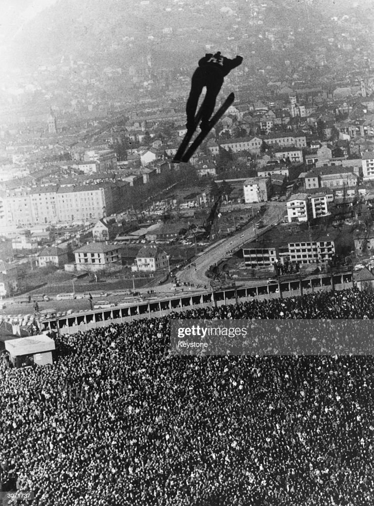 The camera angle gives the impression that German Dieter Bokeloh, after take off from the Berg Isel in the Winter Olympics at Innsbruck, is about to land in the crowd. The event was won by Veikko Kankonnen of Finland, Bokeloh came fourth.