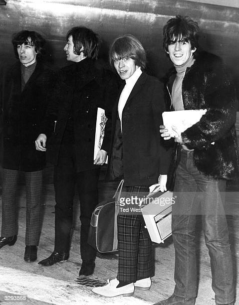 Four members of Britain's top pop group the Rolling Stones at London Airport The band are travelling to the United States where they are to appear on...
