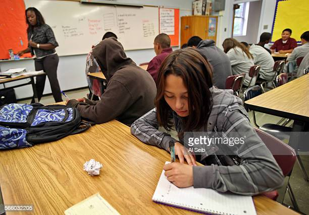 11th grade student Doris Sanchez 16–years–old works on her first paper in the classroom of Ms Marianne Gomis a new French teacher at John C Fremont...